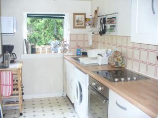 Fully equipped kitchen with electric cooker and hob, washer/dryer, coffee machine, microwave etc.