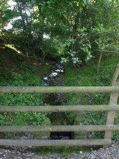 The bridge over the stream to the cottage