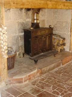 The original kitchen tiles and woodburner in the kitchen - wonderful for winter BBQ's