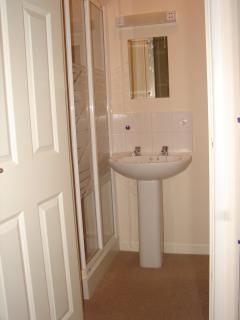 En-suite shower room to bedroom 2.