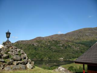 Beautiful 5 star, 2 bedroom chalet with dramatic Highland loch and mountain view