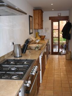Well equipped Kitchen with door leading to the garden.