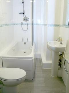 Bathroom (bath with shower over and WC)