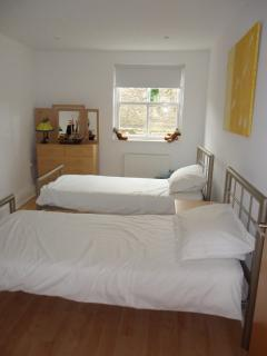 The third bedroom comes with two single beds
