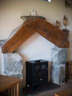 Welsh granite and recycled oak bow of a ship were used to make this fire place