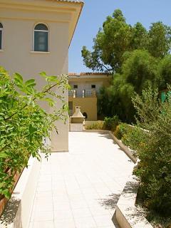 Peaceful Sunny Mediterranean Garden Vista set back from road