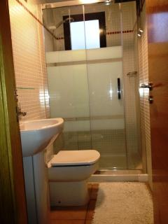 Bathroom with step in shower area