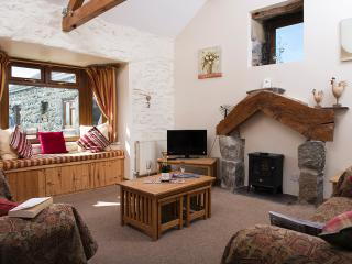 Living room with Welsh stone & Oak fire place,take in the views from the window seat