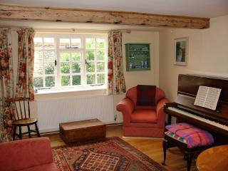 Bright Sitting Room with Piano looking out over Private Courtyard Garden