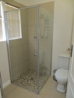 Ensuite shower room with heated towel rails