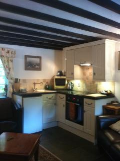 Kitchen, with microwave, 4 ring ceramic  hob, built in oven and larder fridge with a freezer