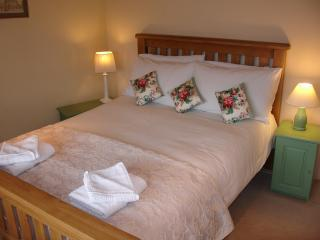 Lovely bright bedrooom: Oak Bed, Harrison Handmade Mattress, Wool Carpet, Bedside Digital Radio