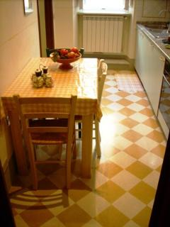 Looking at kitchen with its bright tiled floor