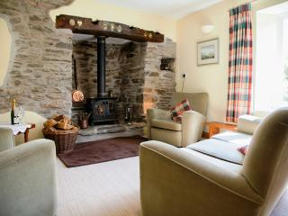 The living room with stone inglenook fireplace, bread oven and salt safe