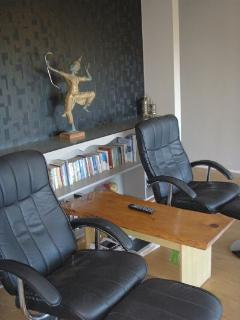 Recline in your leather chairs to watch the view or watch the flat screen tv
