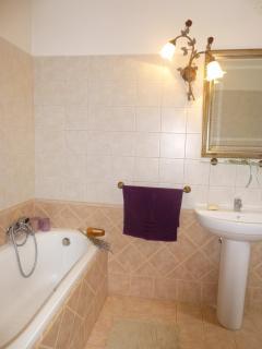 ensuite bathroom of master bedroom with tub