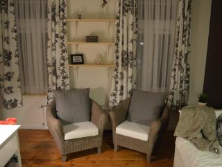 Two comfortable chairs at your disposal in the living room to sit and relax.