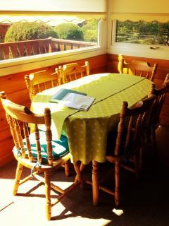 Cosy dining area with wraparound views