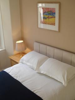 The bedroom has a very comfortable new double bed and is quietly located to the rear of the building