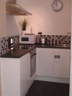 The kitchenette also has a modern fan oven, kettle, toaster and free tea, coffee and sugar.
