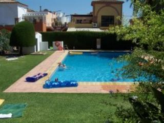 large pool in the centre of the secure private gated gardens of  Benazur owner's aparts.