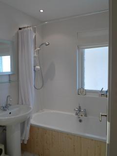 Famly bathroom with shower  over bath