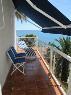 Side terrace. A place to sunbaith in the afternoon. Electric blind. View of Mediterranean Sea/beach.