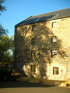 Front of 18th Century Maltings Mill overlooking Budle Bay