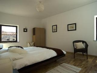 Main bedroom at Casa Geranium, with oak floor and bed