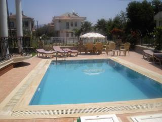Pool with sun bathing and seating areas