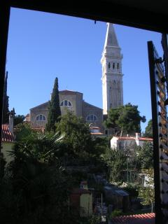 View of St. Euphemia church from the main bedroom window at Casa Geranium