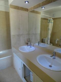 ensuite with bath, overhead shower, double sinks and wc........