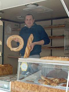 Freddo our friendly breadman delivers fresh baguettes an croissants to your door daily