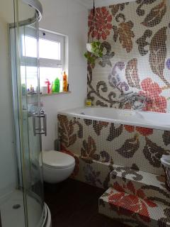 2nd bathroom upstairs with shower and bath