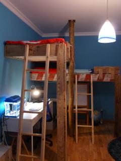 kids room 4 with two high beds. Desk is gone so you can fit another bed or cod, balcony