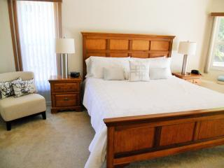 The large master suite has a king sized bed and large en-suite bathroom.
