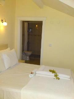 Master double bedroom with air con and en-suite bathroom