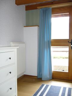 Bedroom with door to exterior