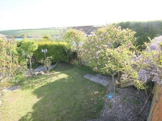 private rear fully enclosed garden well stocked with shrubs