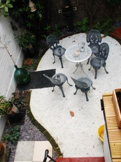 Table, chairs and BBQ.