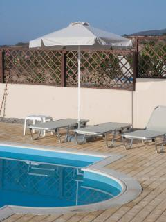 Sunbeds and Umbrella by the Pool
