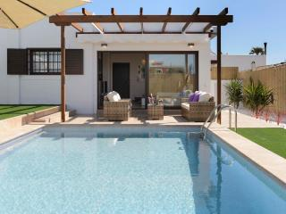 Private swimming pool with lounge area