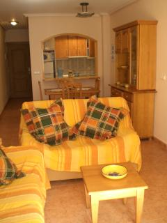 The lounge area with comfortable sofa's, dining table,flat screen TV and airconditioning.