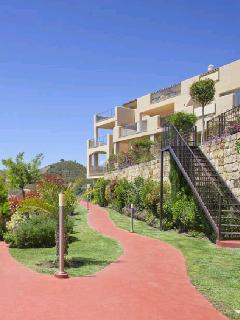 Apartments and pathway to the three complex swimming pools