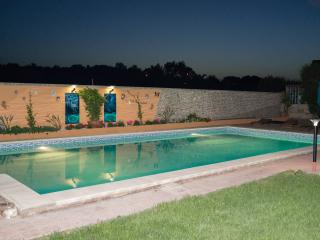 Enjoy the private, solar heated pool at any time, day or night. Solar lighting, pretty gardens.