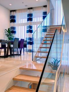 Hall / Entrance area with modern glass railings and wooden staircase