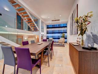 Formal dining area with a contemporary design.