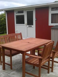 Outside has table and chairs to enjoy the views