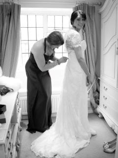 Bride getting ready in the dresssing room
