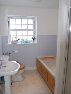 The family bathroom with bath and walk in shower